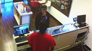 The suspected robber is seen in this surveillance image provided by the Santa Ana Police Department.