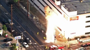 A transformer exploded as firefighters worked to shut off a sheared hydrant in Hollywood on Aug. 27, 2015. (Credit: KTLA)