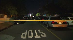 """Los Angeles police fatally shot a man after he attacked an officer with a """"hard object"""" in Van Nuys on Friday, Aug. 28, 2015, officials said. (Credit: KTLA)"""