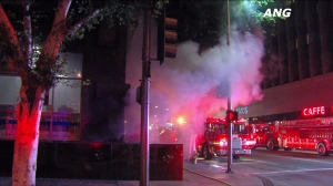 Firefighters responded to an underground explosion and fire Thursday night at a 19-story high-rise building in downtown Los Angeles on Aug. 20, 2015. (Credit: ANG News)