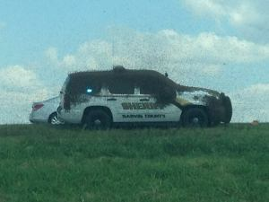 Carl Zink of the Garvin County Sheriff's Office posted this photo of bees swarming an SUV after a big-rig carrying honey bees overturned on Sept. 29, 2015.
