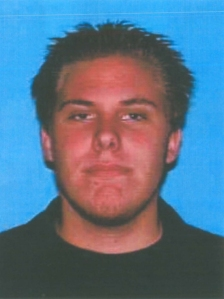 Brett Alan Usher is shown in a DMV photo for a license issued in 2011.