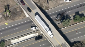 Two SUVs are left on the 215 Freeway after a crash, pursuit and fatal shooting on Sept. 18, 2015. (Credit: KTLA)