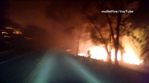 A screenshot from a driver's video shows massive flames burning in the Anderson Springs community of Lake County on Saturday, Sept. 12, 2015. (Credit: mulletFive/YouTube)