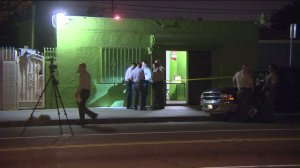 The bodies of two men were found at a marijuana dispensary in Compton on Wednesday, Sept. 23, 2015. (Credi: KTLA)