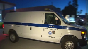 A Los Angeles County coroner's van leaves the county Fire Department's Pacoima Facility, where a firefighter's body was discovered on Sept. 6, 2015. (Credit: KTLA)