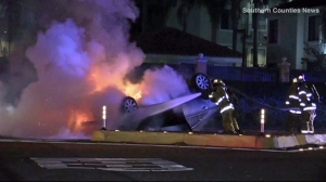 Crews work to put out a car fire in Santa Ana on Sept. 29, 2015. (Credit: Southern Counties News)
