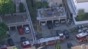One person was found dead in an apartment fire in Westwood on Sept. 21, 2015. (Credit: KTLA)
