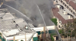 A strip mall caught fire in Monterey Park Wednesday morning. (Credit: KTLA)