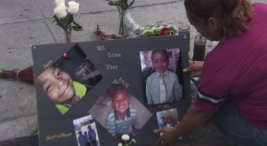 The three slain sons of Luiz Fuentes are shown in photos at a vigil on the day the boys were found dead, Sept. 9, 2015. (Credit: KTLA)