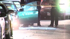 A gunman was sought after a woman was shot in Hyde Park on Sept. 30, 2015. (Credit: OnScene)