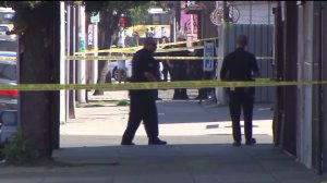 An investigation was underway after police fatally shot an allegedly armed woman in South Los Angeles on Sunday, Sept. 27, 2015. (Credit: KTLA)