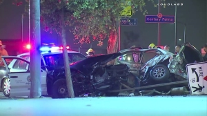 An LAPD car collided with a car it was chasing in South L.A. on Sept. 23, 2015. (Credit: Loudlabs)