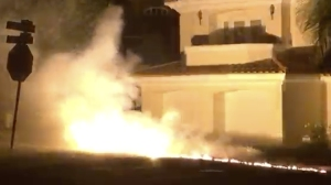 A screen shot from a viewer's video shows flames caused by an apparent downed power line in the area of 11th Street and North Poinsettia Avenue in Manhattan Beach on Sunday, Sept. 20, 2015.