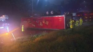 A big rig overturned on a Pasadena area freeway amid heavy rain on Sept. 15, 2015. (Credit: KTLA)