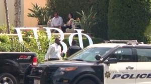 Investigators gathered outside UCLA's Pi Beta Phi Sorority house in Westwood on Sept. 21, 2015. (Credit: KTLA)