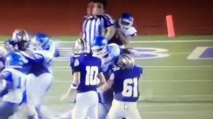 A screenshot from a video shows a referee being hit by a Texas high school football player during a game on Friday, Sept. 4, 2015. (Credit: Greg Gibson/YouTube)