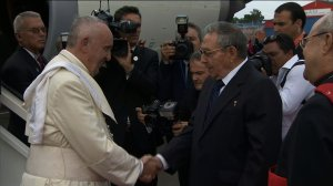 Pope Francis is greeted by Cuban President Raul Castro after arriving at Jose Marti International Airport in Havana on Saturday, Sept. 19, 2015. (Credit: Pool)