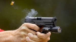 A Smith & Wesson M&P is fired on the range at the Pitchess Detention Center in Castaic. (Credit: Mark Boster / Los Angeles Times)