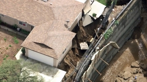 A home appears to be in danger of sliding down a hillside in San Gabriel on Sept. 15, 2015. (Credit: KTLA)