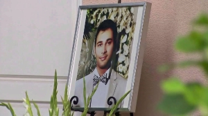 A photo of Shayan Mazroei is seen outside a Laguna Niguel home, where a vigil was held in his honor on Saturday, Sept. 12, 2015. (Credit: KTLA)