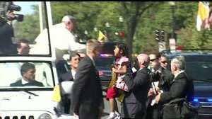 Pope Francis greets Sophie Cruz during a procession in Washington, D.C., on Wednesday, Sept. 23, 2015. (Credit: CNN)