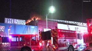 A fire broke out at a building in South L.A.'s Florence neighborhood on Sept. 1, 2015. (Credit: OnScene)