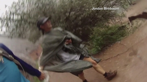 Hikers are seen escaping a flash flood at Zion's National Park on Sept. 14, 2015. (Credit: Jordan Birnbaum)