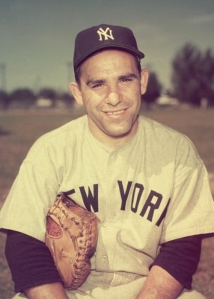 Portrait of American baseball player Yogi Berra in his New York Yankees uniform with a baseball glove under his arm, New York City. (Credit: Hulton Archive/Getty Images)