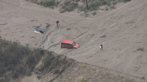 Vehicles were stuck in mudflows in the Lake Hughes area on Oct. 15, 2015. (Credit: KTLA)