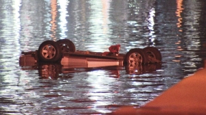 Police say a father drove his SUV into a lake in Phoenix on purpose killing himself, his wife and 3 children. Despite the efforts of fishermen and police diving in to pull them out of the water, there were no survivors. (Credit: KTVK)