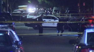 """An """"innocent bystander"""" was killed during a car-to-car shooting in Canoga Park on Oct. 6, 2015, police said. (Credit: KTLA)"""