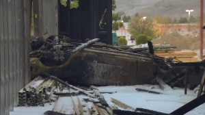 An alleged DUI driver was arrested after crashing a car through an under-construction building in Rolling Hills Estates on Oct. 18, 2015. (Credit: KTLA)