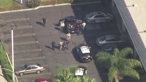 After a CHP pursuit that began in Fontana, a driver pulled into the Pomona Police Department parking lot and was taken into custody on Oct. 20, 2015. (Credit: KTLA)