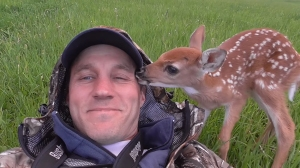 Darius Sasnauskas is shown with a baby deer he rescued in a still image from his video posted Sept. 28, 2015. (Credit: Darius Sasnauskas/honeysada)