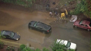 A block in Boyle Heights was flooded after a storm cell moved through on Oct. 19, 2015. (Credit: KTLA)