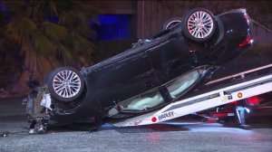 A car overturned in a fatal two-vehicle crash in Hacienda Heights on Sunday, Oct. 18, 2015. (Credit: KTLA)