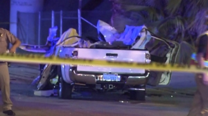 The occupants of a white Toyota Tacoma pickup truck were killed in a violent crash in Hacienda Heights on Oct. 18, 2015. (Credit: KTLA)