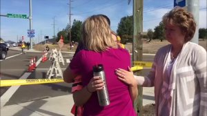 A student gets a hug after a fatal shooting at Umpqua Community College in Roseburg, Oregon, on Oct. 1, 2015. (Credit: KIAH)