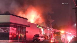 A fire broke out at a commercial building in Huntington Park on Oct. 28, 2015. (Credit: OnScene TV)