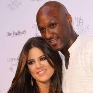 Khloe Kardashian and Lamar Odom pose for photographers during the 'Unbreakable' Fragrance Launch at The Redbury, Los Angeles on April 4, 2011. (Credit: Frederick M. Brown/Getty Images)