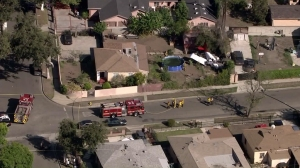 Firefighters respond to a plane crash in Compton on Oct. 7, 2015. (Credit: KTLA)