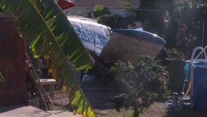 The wreckage of a small plane crash sat in a Compton yard on Oct. 7, 2015. (Credit: KTLA)