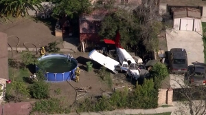 Firefighters responded to a plane crash near Compton/Woodley Airport on Oct. 7, 2015. (Credit: KTLA)