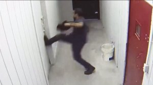 Surveillance video shows an alleged burglar trying to escape from a secure area at a cellular store in Pomona.
