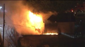 """A """"stubborn"""" attic fire caused """"extensive"""" damage at a South L.A. home on Oct. 30, 2015. (Credit: KTLA)"""