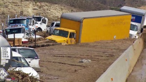 Cars and trucks were stuck in several feet of mud on Highway 58 on Oct. 16, 2015. (Credit: KTLA)