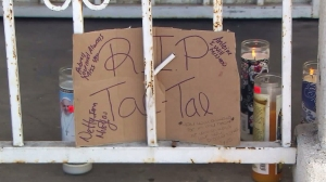 "A sign reading ""R.I.P. Tae-Tae"" was placed on the porch of a South L.A. home following a fatal shooting. (Credit: KTLA)"