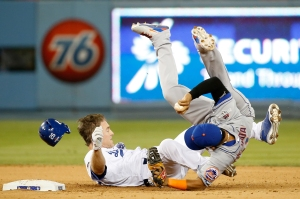 Ruben Tejada of the New York Mets is hit by a slide by Chase Utley of the Los Angeles Dodgers in the seventh inning in an attempt to turn a double play in game two of the National League division series at Dodger Stadium on October 10, 2015 in Los Angeles. (Credit: Sean M. Haffey/Getty Images)