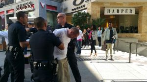 A witness captured this image of a man in custody after a stabbing at Hollywood & Highland on Nov. 18, 2015. (Credit: Shawn Walker)